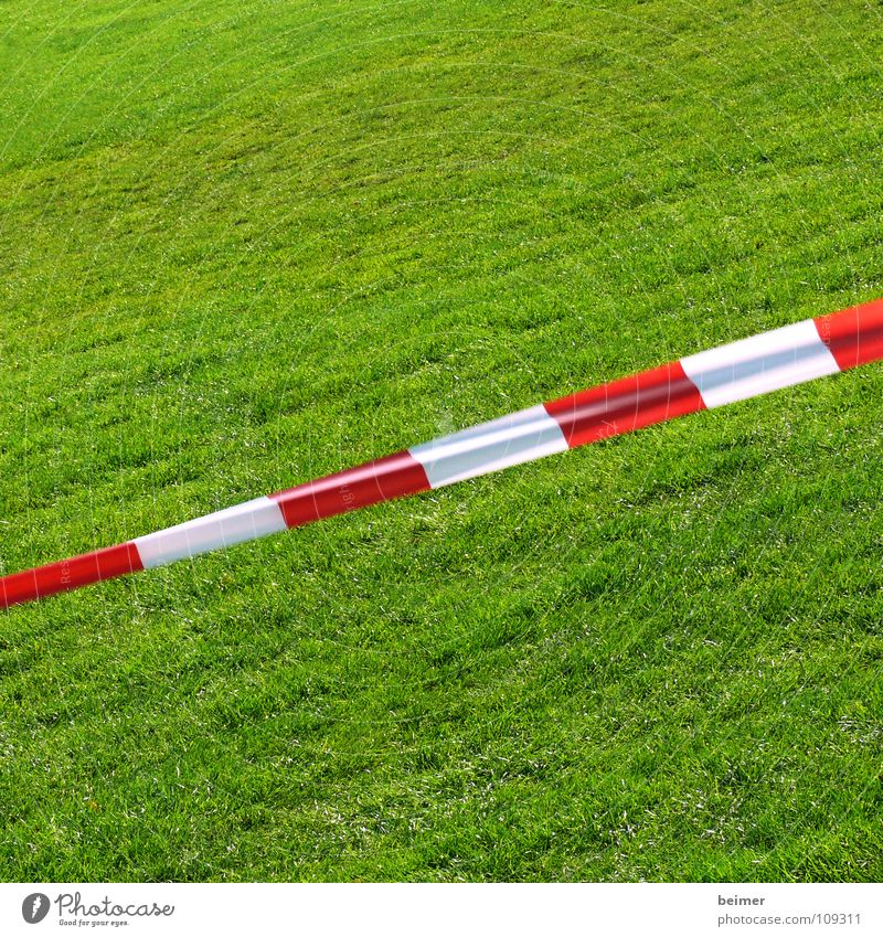 No gambling Lawn Grass surface Barrier String Green Meadow Sporting grounds Striped Red White Diagonal Background picture