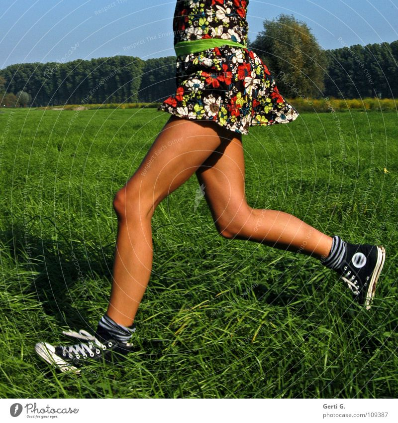Where's it going? Jogging Dress Woman Young woman Thin Firm Wiry Healthy Leisure and hobbies Meadow Hundred-metre sprint Running Chucks Brown Summer Summery