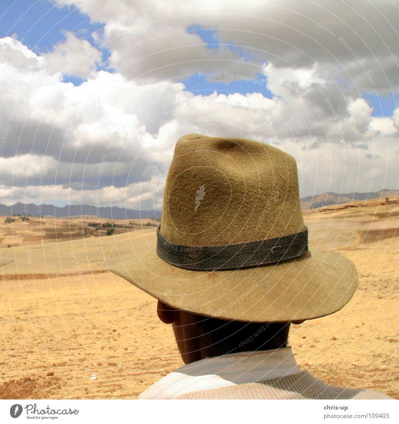 Man Sky White Blue Vacation & Travel Clouds Loneliness Far-off places Mountain Landscape Brown Vantage point Observe Hat Agriculture Farmer