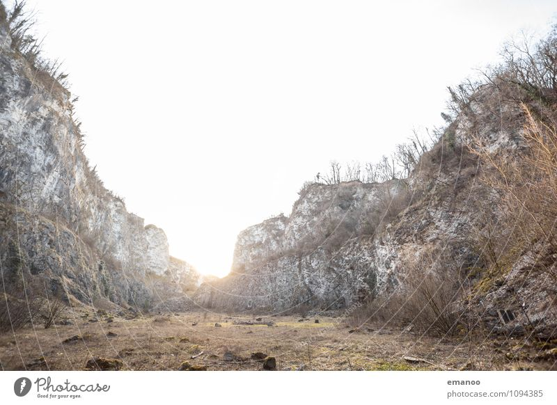 Light in the wall Landscape Plant Sky Sun Climate Warmth Drought Grass Bushes Rock Mountain Canyon Stone Old Bright Gray Wall (barrier) Hollow Breach Quarry