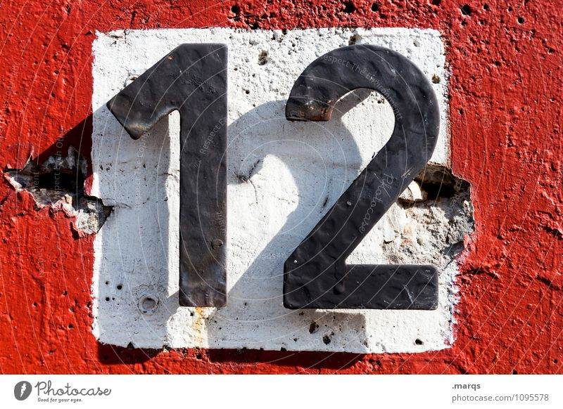 12 Wall (barrier) Wall (building) Digits and numbers Simple Red Black White Age House number Colour photo Exterior shot Close-up Day Light Shadow