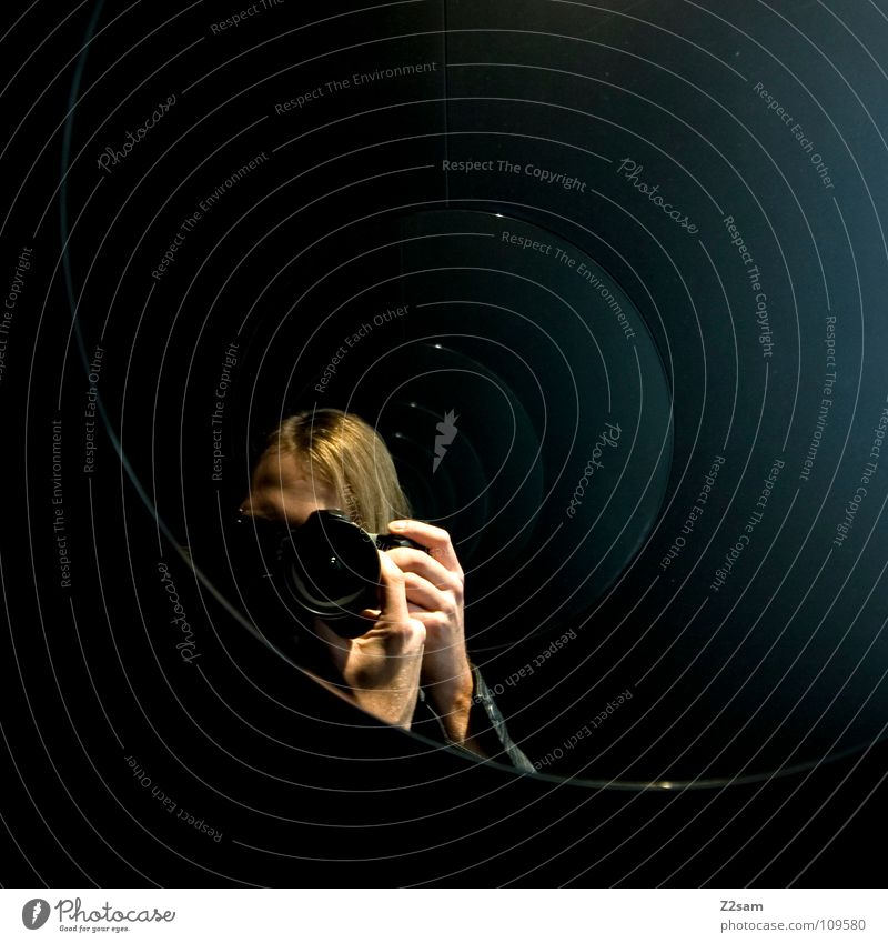 The Photographer Photography Take a photo Mirror Self portrait Circle Mirror image Reflection Frontal Man Blonde Hand To hold on Semicircle Blue tint Black Dark