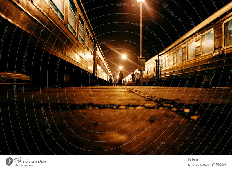 BETWEEN THE TRAINS Railroad Night Dark Driving Asphalt Light Lantern Eerie Criminal Public service Train station Asia train darkness go with Floor covering