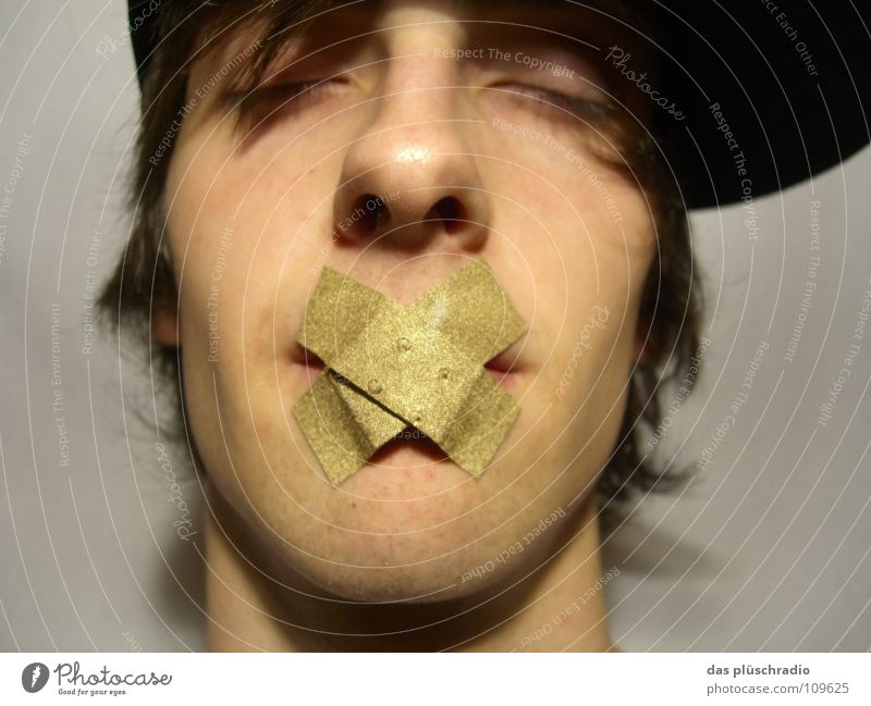 psst... Adhesive plaster To be silent Closed eyes Lips Baseball cap Communicate Gold Face Calm silence is gold Nose