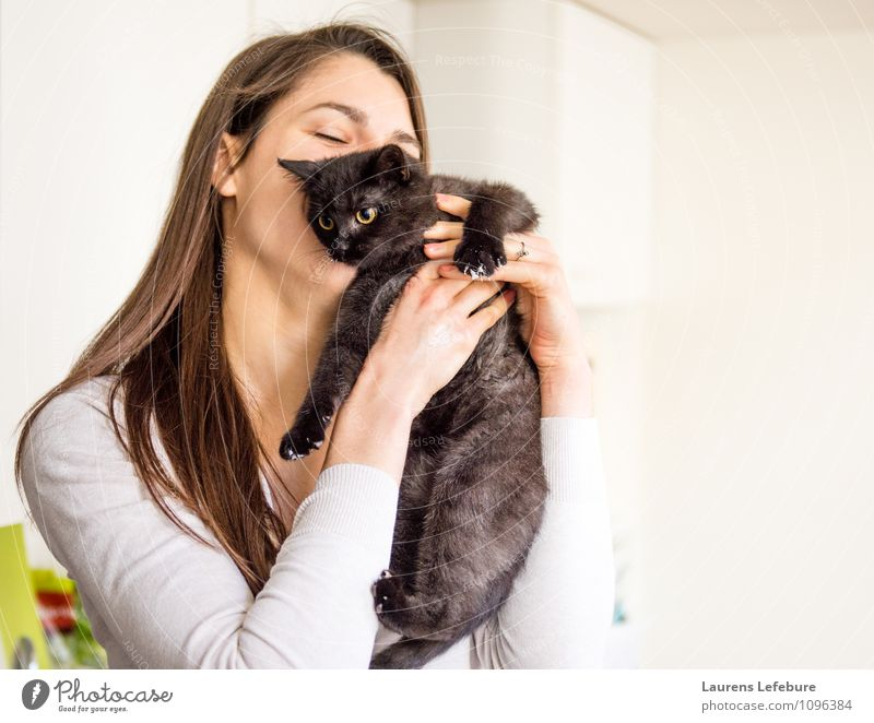 girl hugging cat Pet Cat Kissing Embrace cuddle young cat young animal Girl love Animal lover Cute housecat Lifestyle Funny Humor Portrait photograph