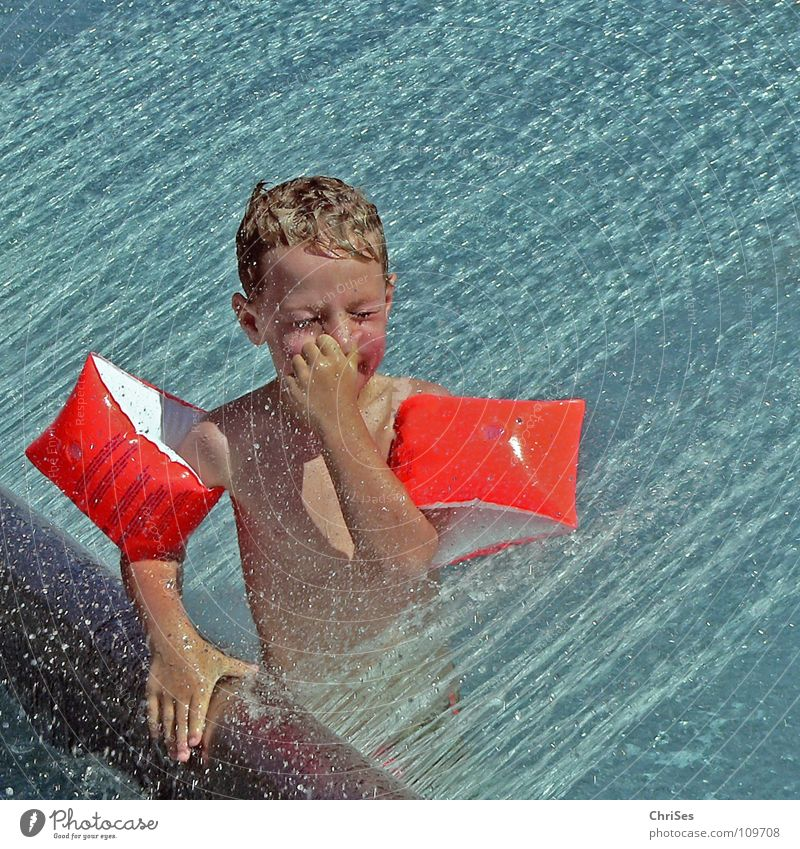 eyes to and through Water wings Closed eyes Summer Swimming pool Vacation & Travel Refreshment Playing Cold Wet Allgäu Joy waterfall Boy (child) Inject Orange