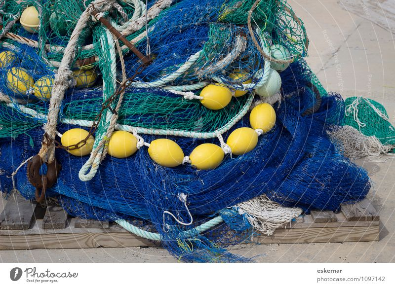 cross-linked Harbour Net Fishing net Maritime Blue Yellow Network Fishery Spain Interlaced fish enmeshed entangled Colour photo Exterior shot Deserted