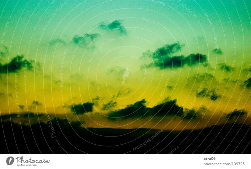 green-yellow sky in landscape format Green Yellow Clouds Night Sunset Sky Mountain Evening