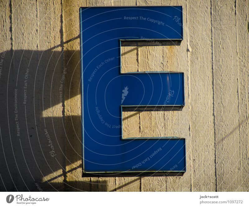 as E Typography Wall (barrier) Wall (building) Concrete Plastic Characters Large Modern Reliability Blue Success Power Authentic Colour photo Exterior shot