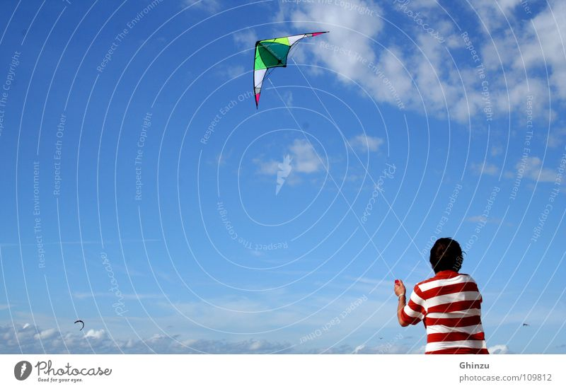 Kite runner Kiting Red White Man Beach Playing Celestial bodies and the universe Youth (Young adults) Sky heaven blue Dragon june Hang gliding Flying fly
