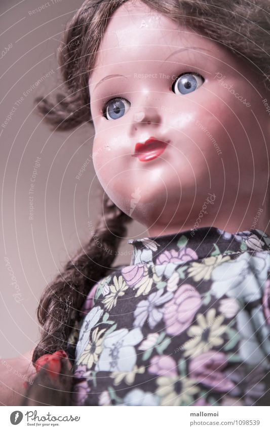 old doll with braids Girl Infancy Face Toys Doll Old Loyalty Memory Playing Friendship Braids Past Motionless Gaze Colour photo Interior shot Forward Downward