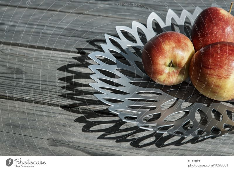 A bowl with three apples on a rustic wooden table Food Apple Nutrition Breakfast Organic produce Vegetarian diet Diet Fasting Bowl Healthy Healthy Eating Gray