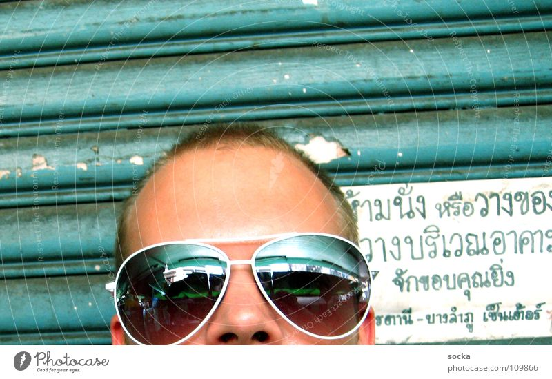 Sunglasses @ thailand Man Mirror Garage Turquoise Green Thailand Bangkok Short haircut Vacation & Travel Letters (alphabet) Characters Signs and labeling Head