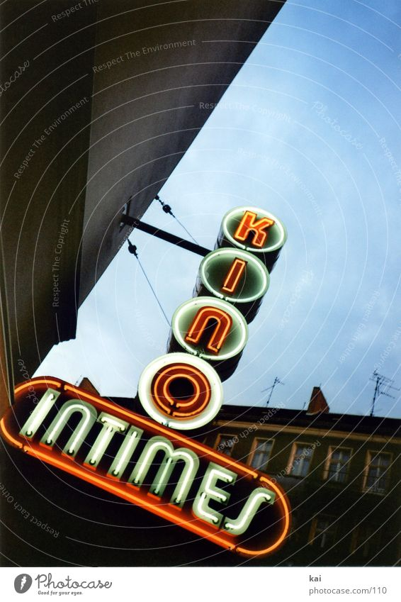 It's a movie. Cinema Neon sign Retro Historic Town Friedrichshain Old cinema intimate Sky Berlin Nostalgia Neon light Signs and labeling Lighting Intimacy