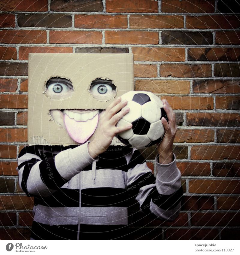 Playing football Man Cardboard Whimsical Humor Wall (building) Freak Square Brick Joy Face Mask Hiding place Hide Stone Ball Soccer Sports square skull