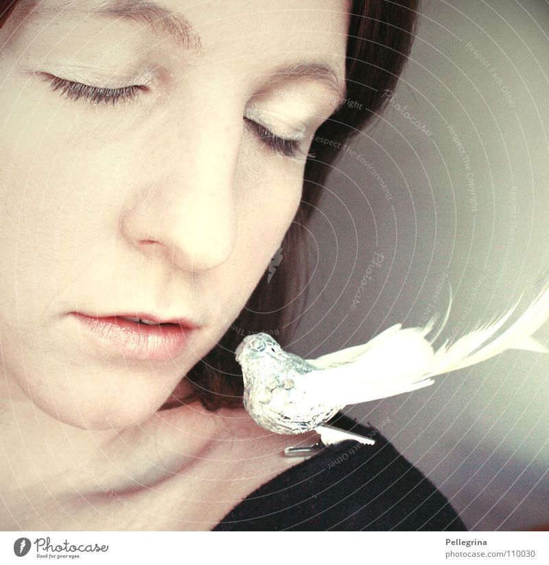 Woman White Calm Face Eyes Bird Mouth Glittering Nose Feather Decoration Soft Lips Shoulder Neck Pallid