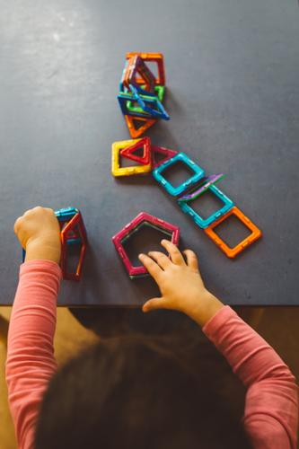 Human being Child Blue Hand Yellow Playing Gray Pink Orange Infancy Arm Study Curiosity Planning Education Toys
