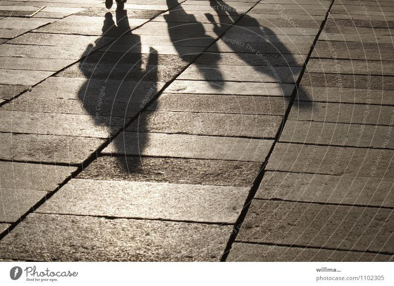 downsides Group people 3 persons Family Places Sightseeing City life To go for a walk Weekend Shadow play Paving tiles Family outing Light and shadow Tourism