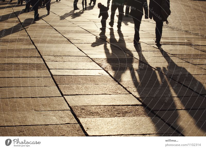 The shadow treader Human being Child Couple Group Places Marketplace Going To go for a walk Relaxation Shadow Shadow play Shadow child Evening Shopping district