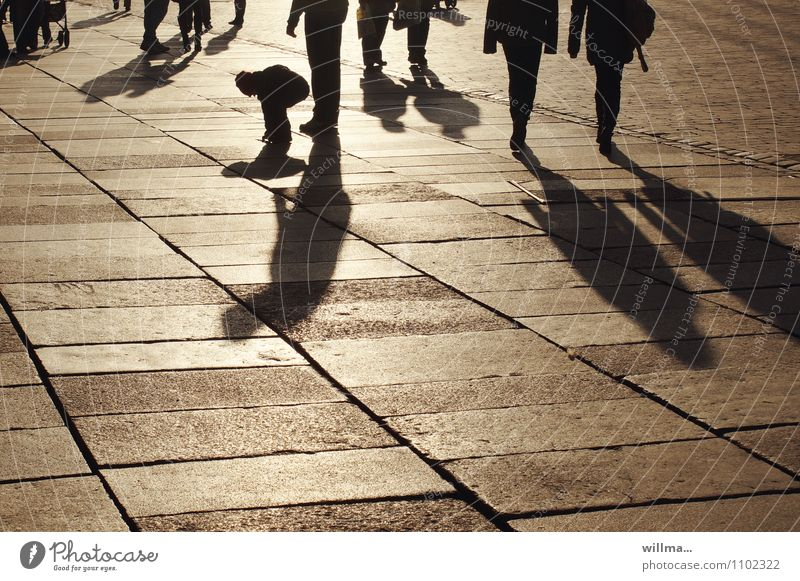 The Shadow child Family Human being Child Group Sunlight Populated Places Marketplace Town Shopping district Shopping arcade Shadow play To go for a walk