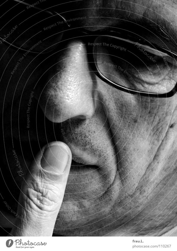 thumb Man Thumb Eyeglasses Reading Think Thought 50 plus Portrait photograph Concentrate Magazine Face ponder Wrinkles young old Dreamily