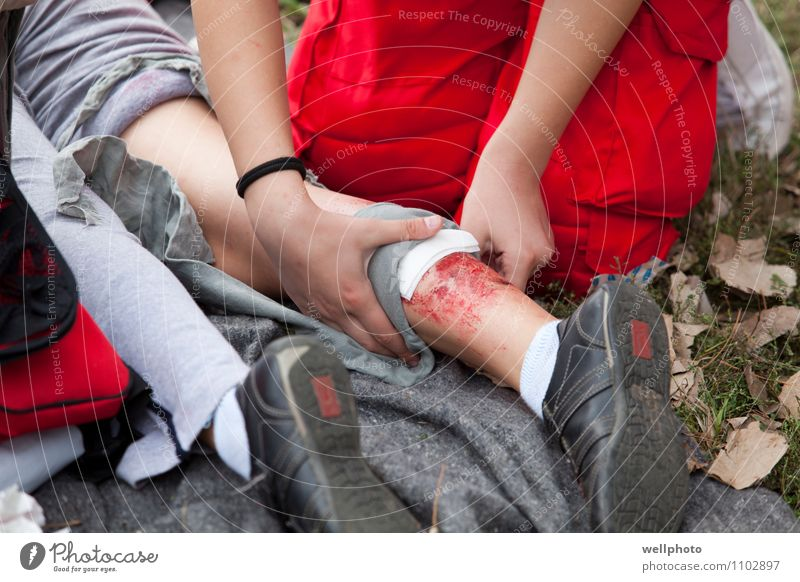 First aid training Human being Nature Youth (Young adults) Relaxation Hand Red 18 - 30 years Adults Grass Healthy Legs Health care Work and employment Park Body
