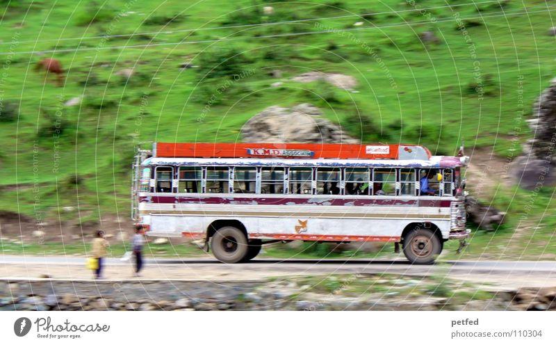 ... from Srinagar to Gulmarg ... India Jammu, Ladakh, Kashmir Green White Driving Vacation & Travel Street Logistics Bus Human being Mountain Orange Boy (child)