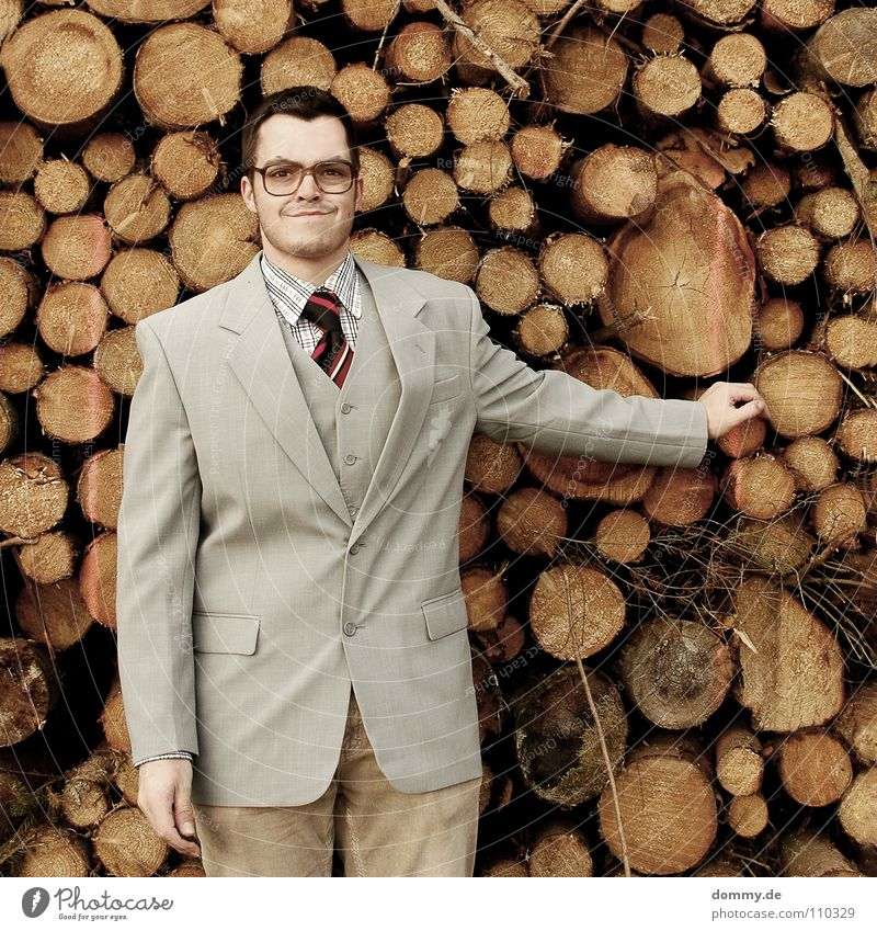 I always need it! Man Fellow Suit Jacket Vest Gray Brown Pants Tie Striped Hand Bright Theft Purloin Tight-fisted Fantastic Eyeglasses Stack of wood Wood