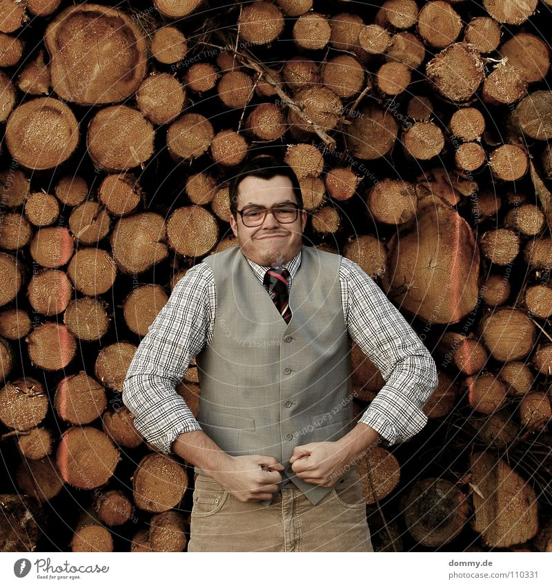 but now Man Fellow Suit Jacket Vest Gray Brown Pants Tie Striped Hand Bright Theft Purloin Tight-fisted Fantastic Eyeglasses Stack of wood Wood Firewood Heat
