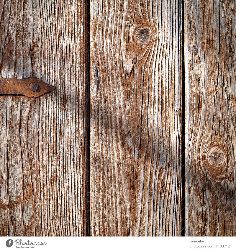 board stories Door Sign Esthetic Authentic Near Dry Wooden wall Derelict Wood grain Rust door frame Iron Brown Washed out Colour photo Subdued colour