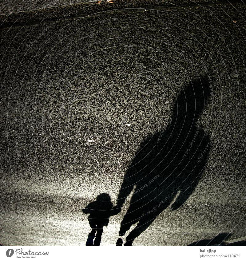 Don't go with the shadow man. Child Man False Criminality Shadow child Dark side Sidewalk Pedestrian Black To go for a walk Back-light East Pavement Granite
