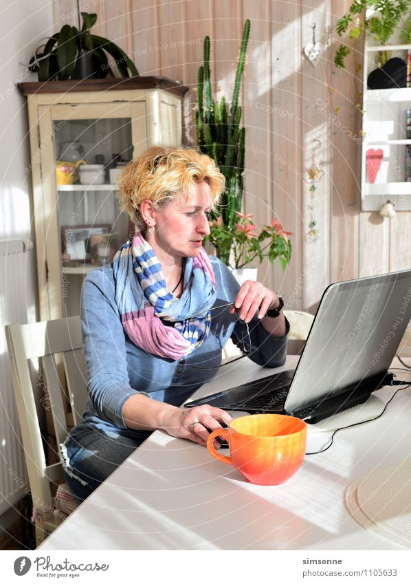 Woman at home Coffee Cup Hair and hairstyles Life Leisure and hobbies Living or residing Flat (apartment) Furniture Table Kitchen Work and employment Office