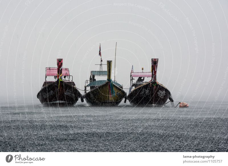 side by side Bad weather Rain Thunder and lightning Ocean Lake Koh Mook Thailand Asia Boating trip Fishing boat Longtail Longboat Attachment Colour photo