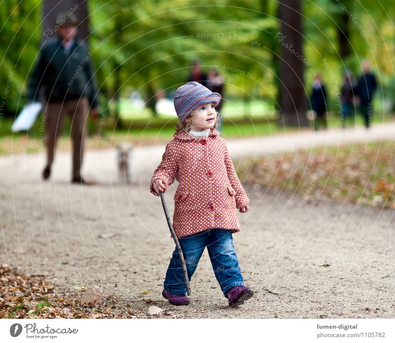 Child goes for a walk in the park Joy Hiking Human being Girl 1 1 - 3 years Toddler Nature Autumn Park Coat Cap Going Laughter Friendliness Small Movement
