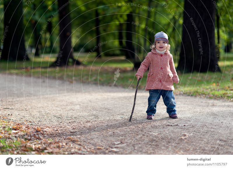 Child with walking stick Joy Athletic Hiking Girl 1 Human being 1 - 3 years Toddler Nature Autumn Park Coat Cap Going Laughter Friendliness Small on one's own