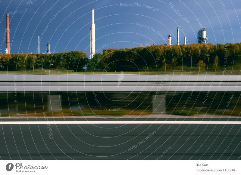Industry Crash barrier Traffic lane Bushes Green Speed Wind Smoke Blue sky Movement Chimney Tall Exhaust gas Industrial Photography Motion blur Lane markings