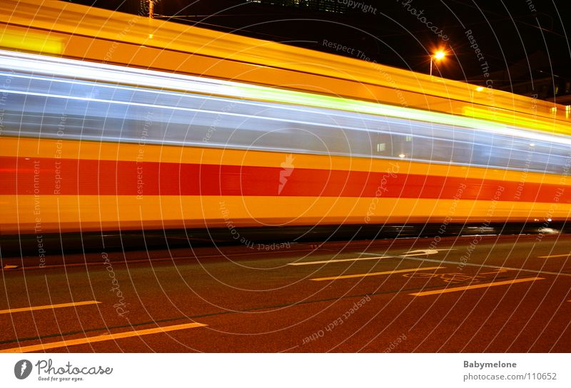 At express train speed Tram Transport Town Basel Railroad Railroad tracks Yellow Red Speed Long exposure Blur Night Dark Movement motion Train station Street
