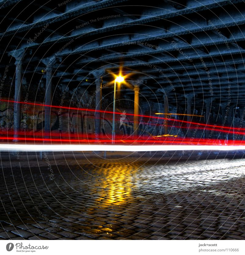 Velocitas Prenzlauer Berg Bridge Tunnel Steel carrier Traffic infrastructure Street Cobblestones Street lighting Tracer path Graffiti Driving Dark Historic