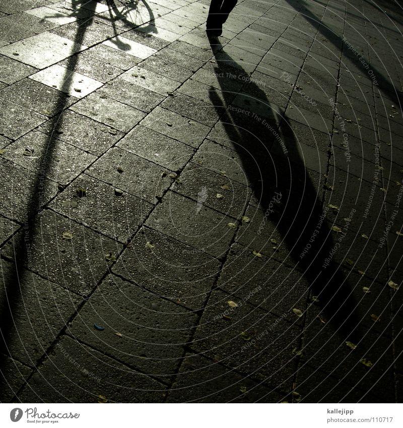 turn around Work and employment Unemployment Identity ID card Foreigner Marginal group Man False Criminality Bicycle Shadow child Dark side Lantern Sidewalk