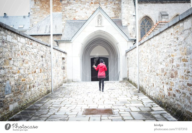 Woman with a red jacket walks towards the door of a monastery church Feminine Adults 1 Human being Old town Church Wall (barrier) Wall (building) Going Fresh