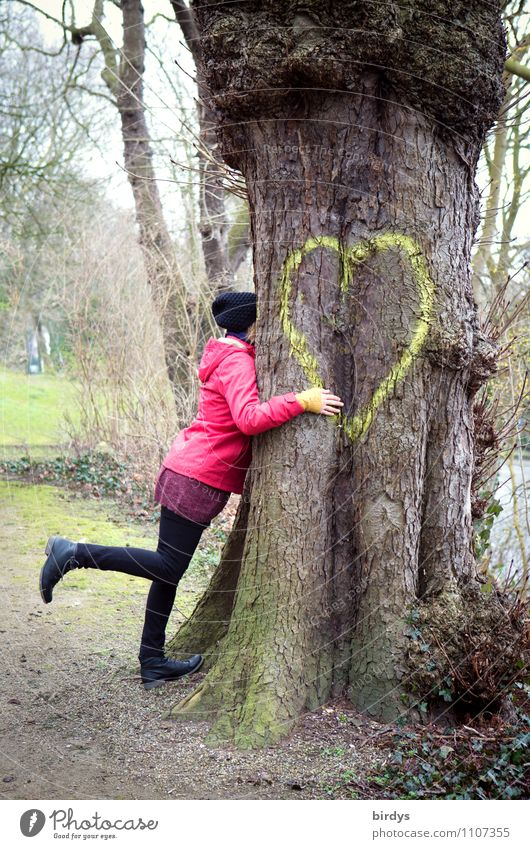 Happy woman hugs a big tree with a heart Young woman Youth (Young adults) Woman Adults 1 Human being 30 - 45 years Park Heart Sign Touch Love Embrace Authentic