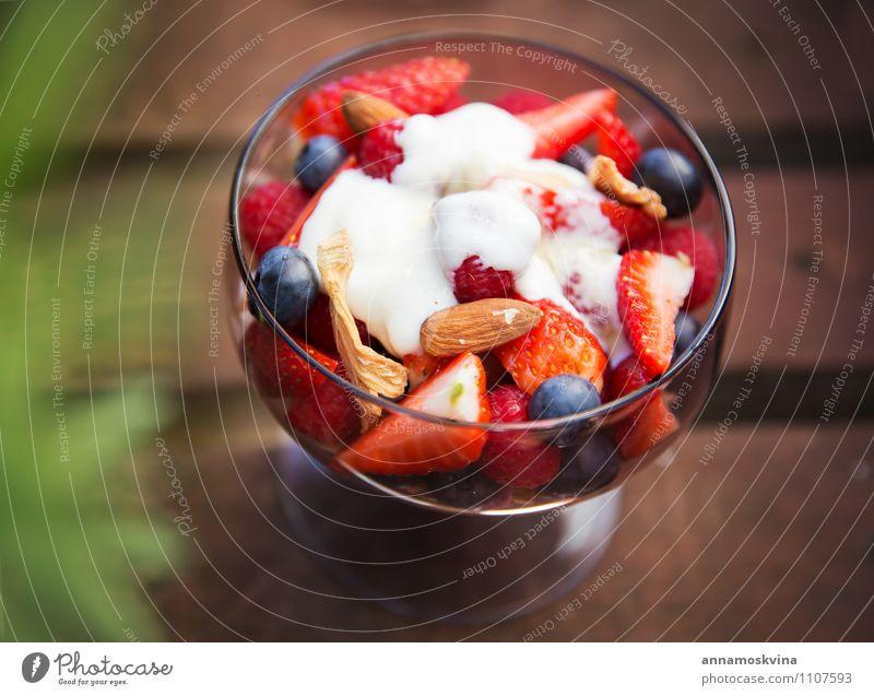 Fresh yogurt with fruits and muesli on breakfast Yoghurt Fruit Dessert Nutrition Eating Breakfast Diet Bowl Red White Cereal healthy Salad food Berries cream