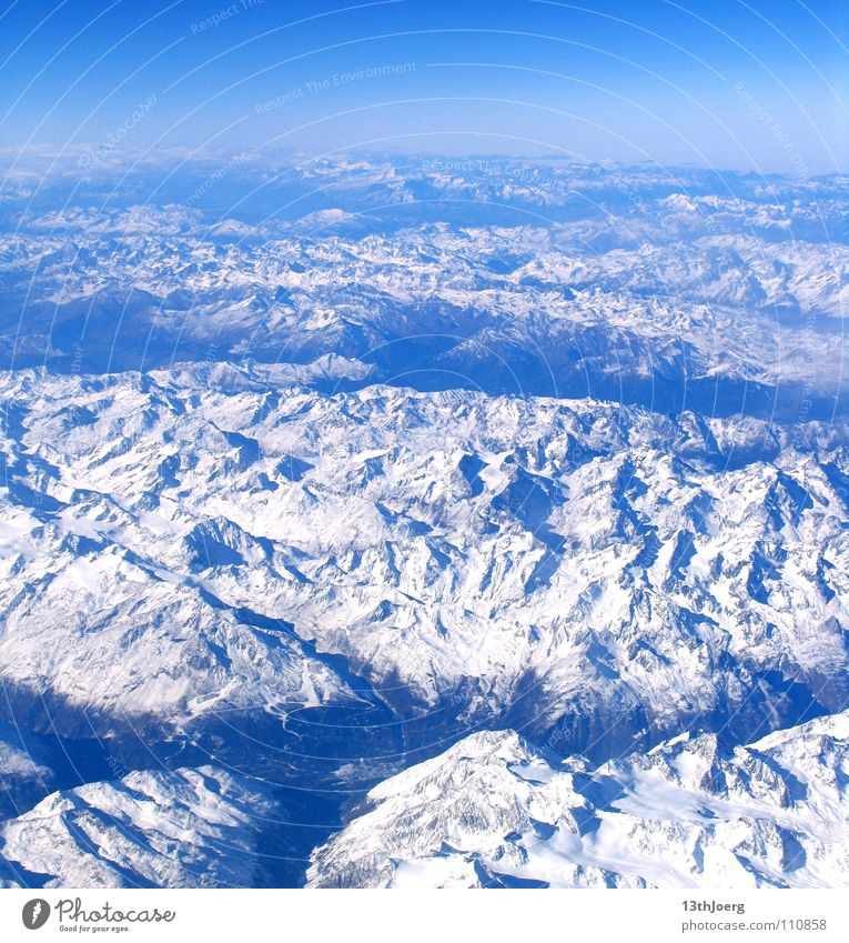 AlpsOverview Aerial photograph White Valley Relief Canyon Austria Horizon Background picture Mountain Europe Winter Aviation Snow Geography Topography Moody