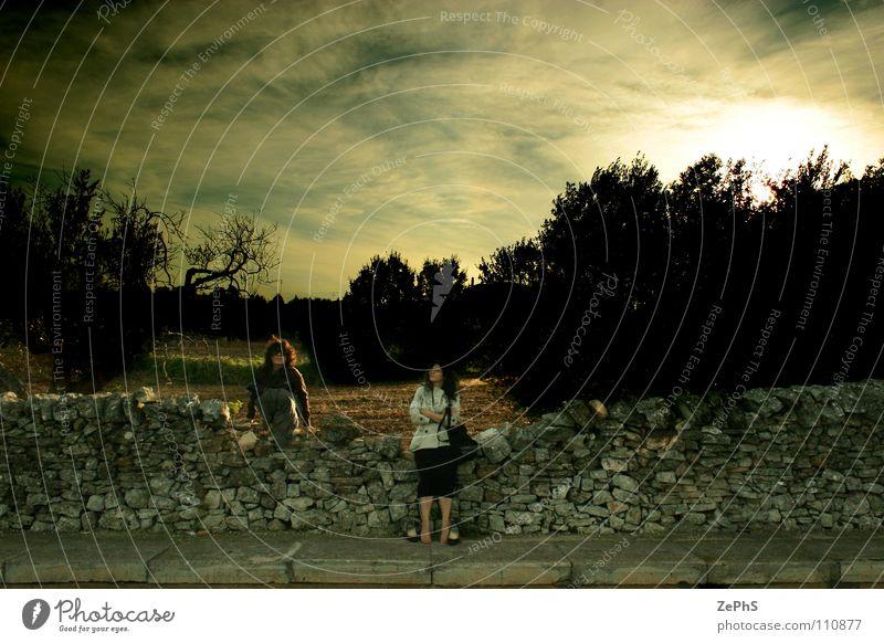 Woman Sky Clouds Colour Dark Wall (building) Wall (barrier) Rain Fear Wait Gale Cobblestones Storm Expectation Panic Dramatic