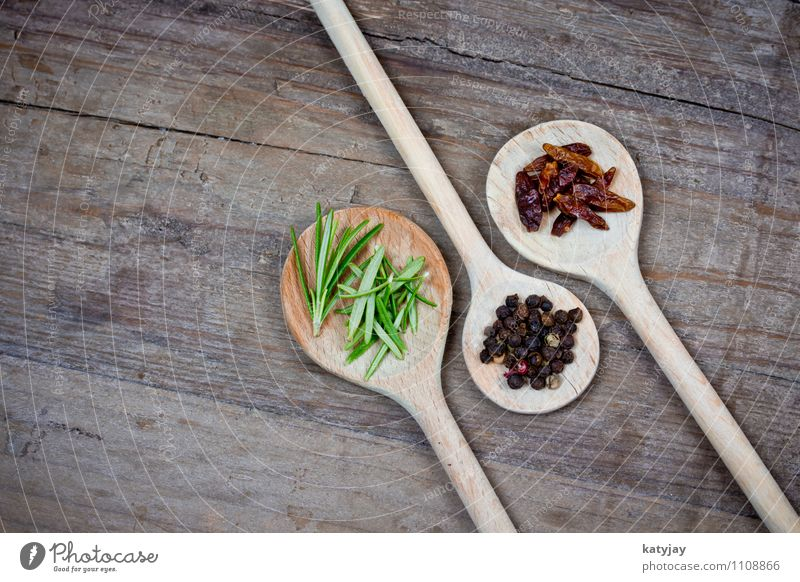 spices Pepper Peppercorn Herbs and spices Rosemary Cooking Kitchen Ingredients Wooden spoon Chili Dried Nutmeg Table Wooden table Near Close-up