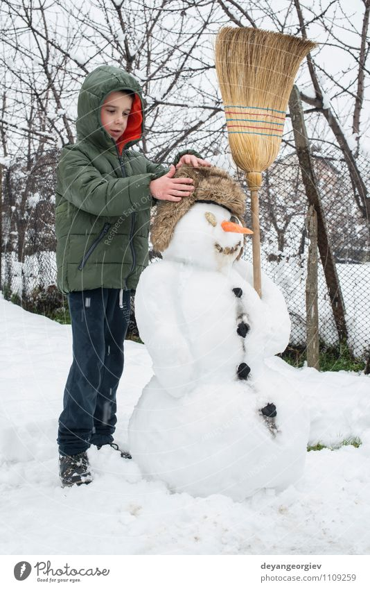 Snowman and child in the yard Joy Happy Playing Vacation & Travel Winter Child Boy (child) Woman Adults Infancy Nature Building Hat Smiling Happiness White kids