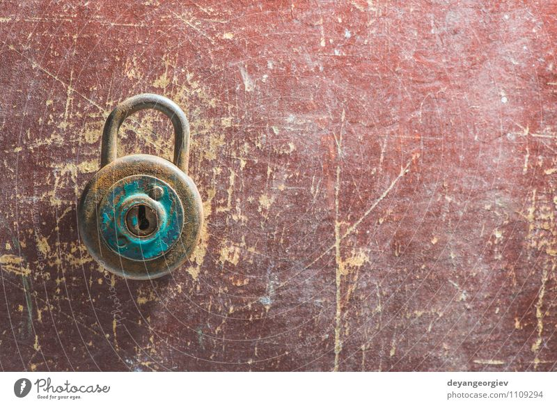 Old vintage padlock on wooden background Door Metal Steel Rust Dirty Retro Brown Safety Protection Safety (feeling of) Padlock Antique Grunge Object photography