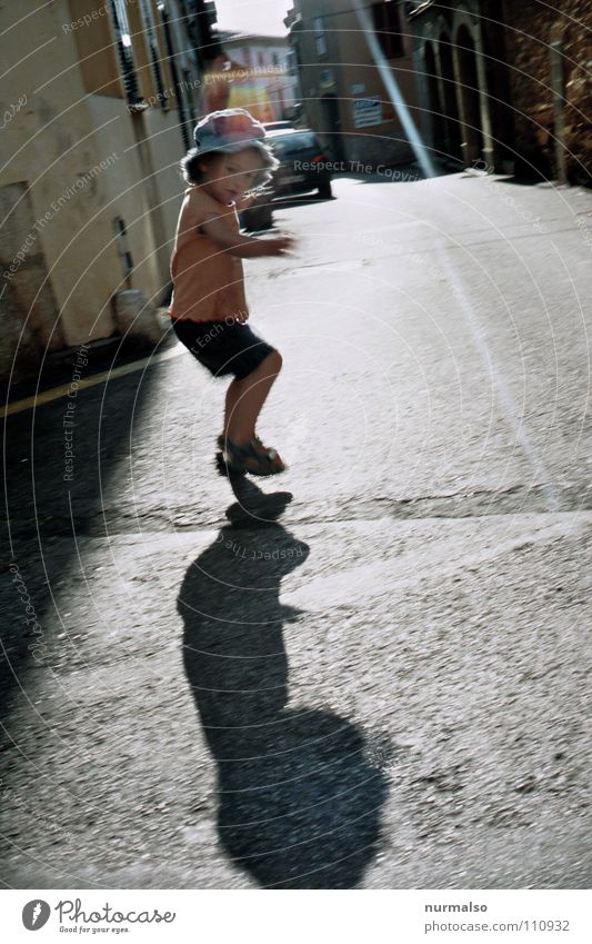 shadow play Shadow play Child Hop Jump Playing Childlike Alley Play street Traffic infrastructure Joy Girl 3 years own shadow Movement yourself Nature Free