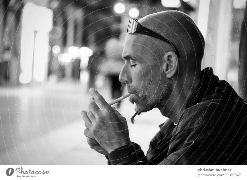 smoking man at night Healthy Smoking Relaxation Night life Going out Masculine 30 - 45 years Adults Capital city Bald or shaved head Threat Cool (slang)