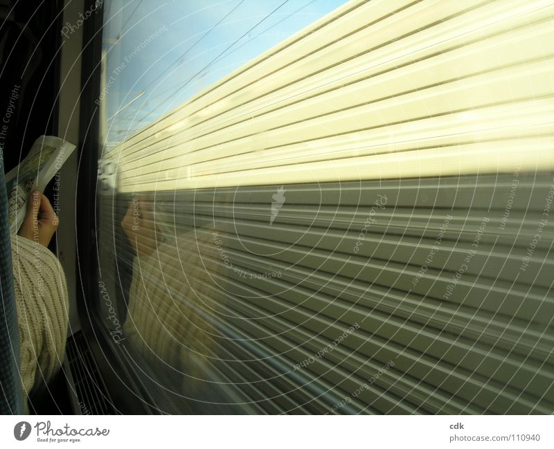 inside & outside Railroad Express train Speed Means of transport Transport Time Bypass Railroad tracks Window Driving Reading Inform Newspaper Hand Shoulder